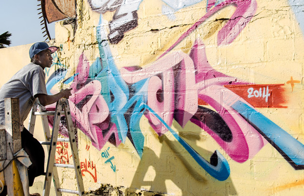 Mow, a leading young graffeur and festival organizer, paints a mural for Festigraff 2014.