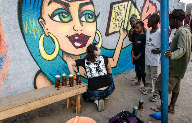 Wall #1: Spray can artist Agana, from Oakland, California, shares her mural with a group of neighborhood children.
