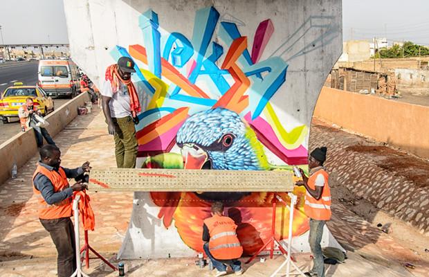 Wall #3: Togolese artist Sitou Matt Imagination paints a highway stanchion.