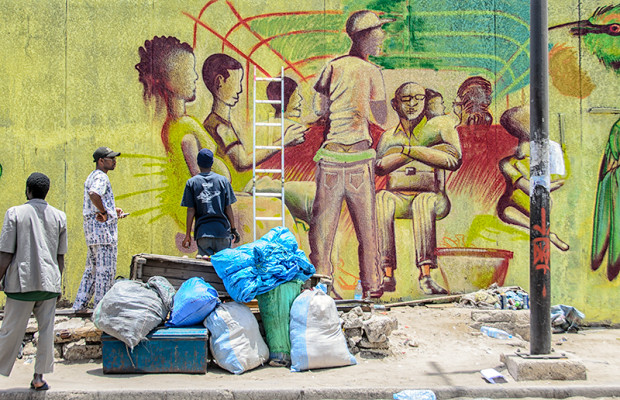 Wall #4: Senegalese graffeur Mbautta paints the inside of a crowded car rapide like the one in Slide 13.