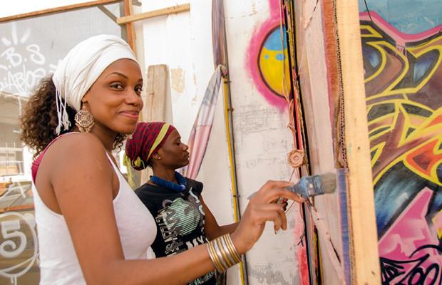 Louise Thiongane and Mame Khady Badji hone their graffiti skills at the Festigraff Artists' Village.