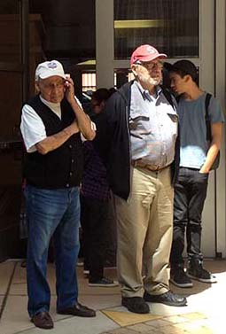 Bob Dominguez left and Francisco Camplis, right, watch the opening ceremony of the Latino history project.