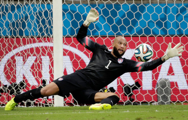 Tim Howard displaying his mastery of goalkeeping against Belgium. Photo from Felipe Dana of the Associated Press.