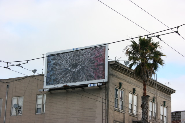 Andrew Schoultz' watchful eye is mounted above Mission Street between 17th and 18th streets.