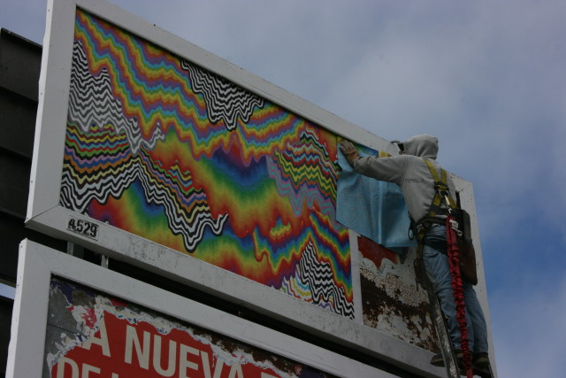Advertising space on 16th and South Van Ness is covered by Jenn Stark's colorful diptych. Photo by Laura Wenus