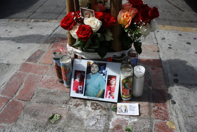 "A roadside memorial was set up on Saturday morning in front of El Cafetazo on 16th St., but no details yet on the exact location of the shooting nor on the suspects or victim. The photo says ""Rest in Paradise Benny"". Photo by Joe Rivano Barros."