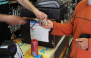 A customer purchases a drink at That's It market on Mission and 23rd streets