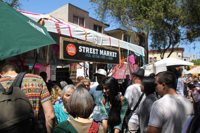Whole Foods had a street market area with vendors selling food and other goods at smaller booths. Photo by Joe Rivano Barros.