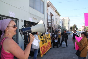 Ana Slavicek, co-chair of the Mission/Bernal Heights ACCE chapter chanting outside a Fong property on York Street. Photo by Joe Rivano Barros.