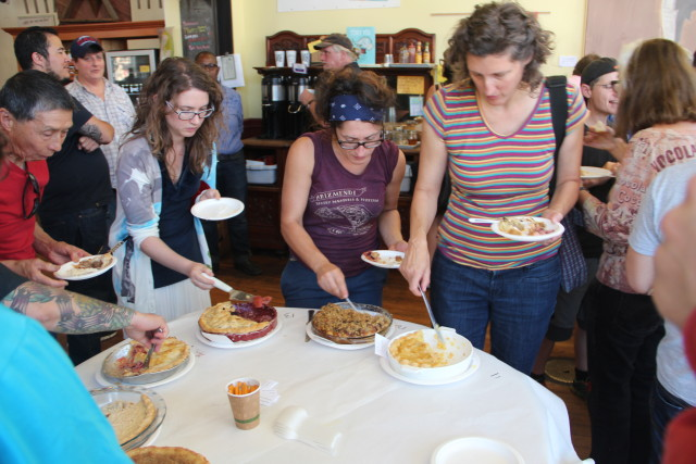 People scooped a small piece of each pie to determine the popular favorite. Photo by Joe Rivano Barros.