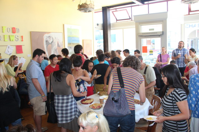 Mission Pie was quickly filled as crows gathered at different tables to taste test the free pies. Photo by Joe Rivano Barros.