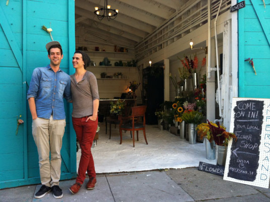 Benjamin Boso and Emerson Boyle outside their garage shop on 80 Albion Street, at 16th.