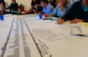 Mission residents write out comments on the plans for a new, revamped Mission street.Photo by Laura Wenus.