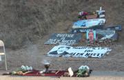 An altar on Bernal Hill commemorating Alex Nieto. Photo by Daniel Hirsch.