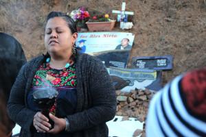Lorena de la Rosa leads a prayer to remember Alex Nieto. Photo by Daniel Hirsch.