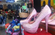 A pair of pink sparkly heels among the racks of vintage goods at Clothes Contact. The thrift store is set to close at the end of the year. Photo by Leslie Nguyen-Okwu.