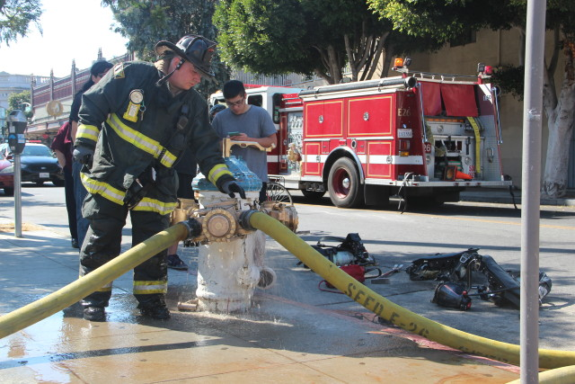 Bartlett Street and 22nd. Firefighter hooking up a high pressure hydrant. Photo 3:50p.m. Photo by Leslie Nguyen-Okwu