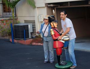 Resident and volunteer volunteer Margie Ramirez and her son Jose position one piece.