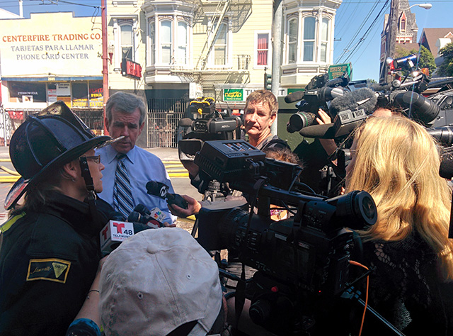 Mindy Talmadge, a spokesperson from the fire department informing the media. At around 3:40p.m. Photo by Laura Wenus