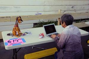 Volunteer Tomoko Lipp reviews inventory with doggie assistant.