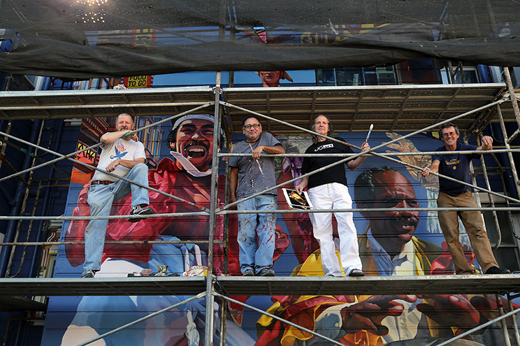 Original Artists Reunite at Carnaval Mural