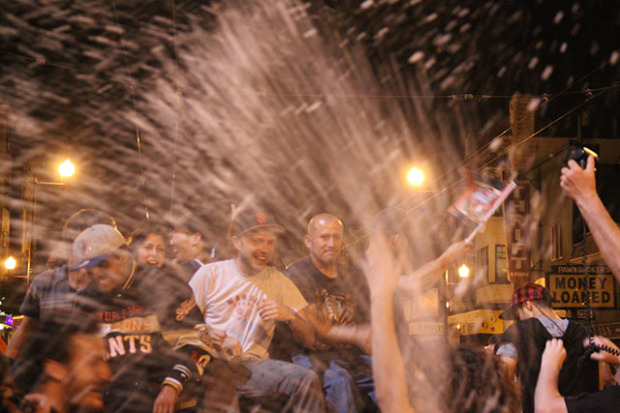 Champagne, fires and police were the theme in the Mission District. Photo by Laura Wenus.