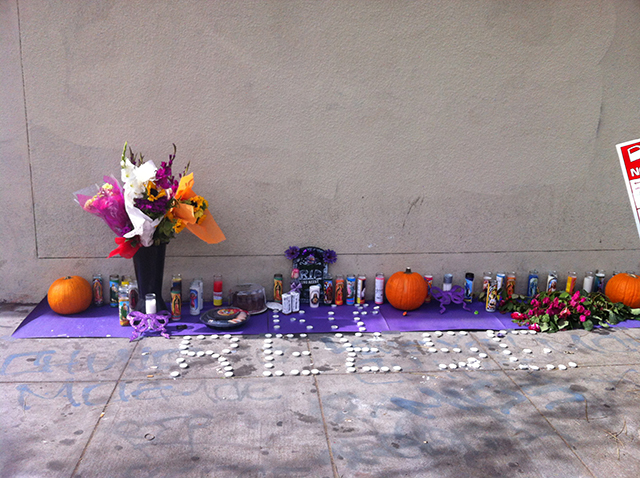 The altar set up on Bartlett and 21st to remember Maurice White. Photo by Andrea Valencia