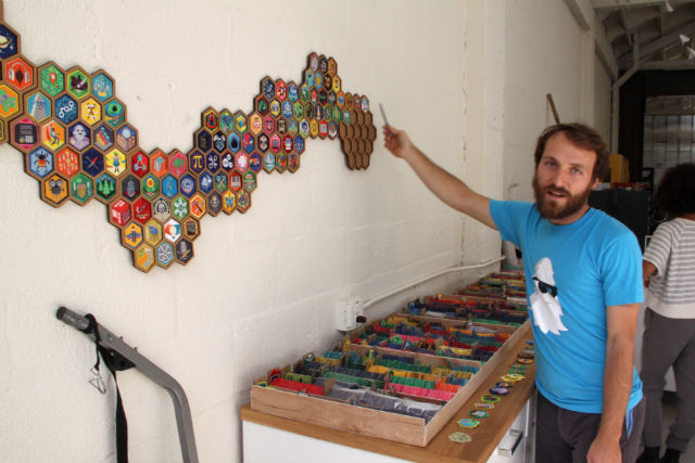 Paul Long displays the patches of DIY.org. Photo by Daniel Hirsch.