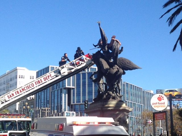Rescue Crews Work to get Man off Dolores St Statue (Updated)