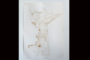 One of the drawings from the map tablets with dirt from the soil where it was placed. Photo courtesy of Miguel Arzabe.