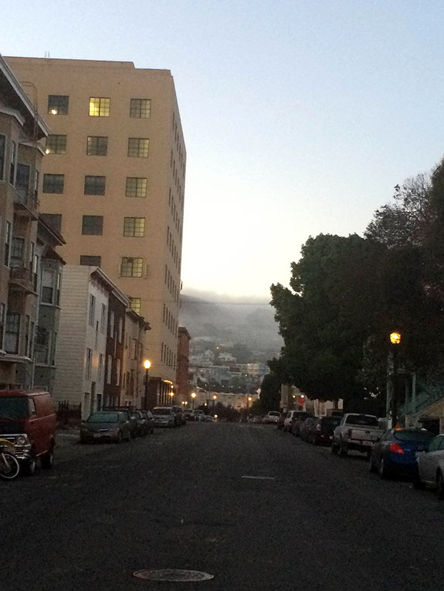 View down Capp street, heading towards 25th. Karl the Fog must of gotten bored with the Mission at night and headed to Bernal Heights Park.  Photo by Eugeniya Kirovskaya