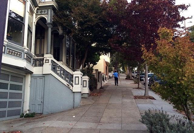 Early morning sidewalk sweeping on Fair Oaks. Photo by Mark Rabine.