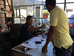 Ulysses talking to a customer at 76 Lube at Potrero and 23rd Streets.
