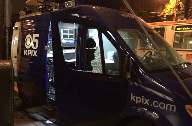 News truck struck by protesters. Windows shattered, tires knifed. Photo by Daniel Mondragon