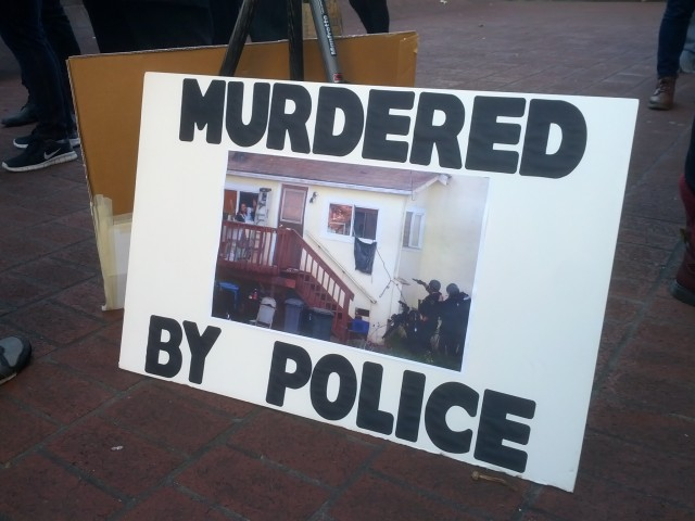 Sign at Solstice march against police violence. Photo by Daniel Hirsch.