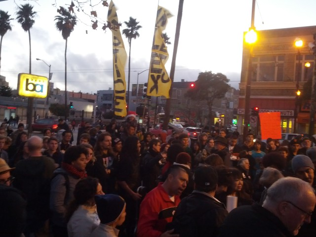 The Solstice march against police violence at the 24th Street Bart plaza. Photo by Daniel Hirsch.