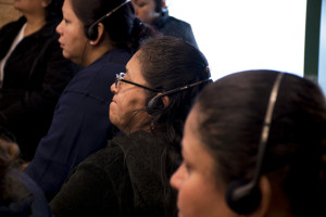 Business women listening to the translation on what is available in city help. Photo by Lola M. Chavez