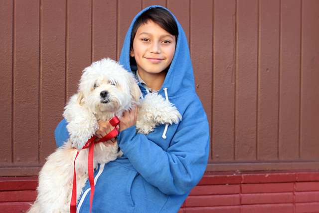 Alessandro Gonzalez, 13, jumped out the window with his dog Buddy. Photo by Daniel Mondragón