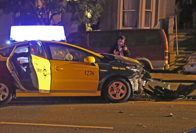 Cab driver learning of his injuries and reporting the accident. Photo by George Lipp
