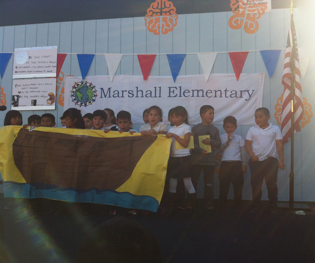 Marshall Elementary students performing the song El Barco on stage during the schools 100th anniversary. Photo by Andrea Valencia