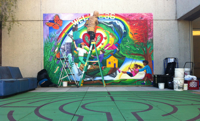 A volunteer working on the Wellness mural on the 7th floor of SFGH. Photos by Andrea Valencia