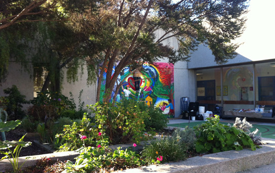 Another view of the Wellness mural, next to the garden in the patio.