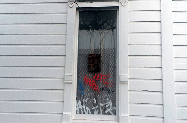 Bullet hole, graffiti and chicken wire. How quintessentially Mission. Photo by Eugeniya Kirovskaya