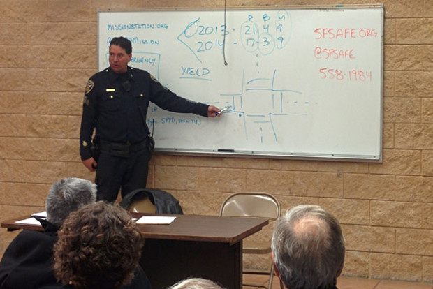 Sgt. Murray outlines intersection etiquette at a the monthly community police meeting at Mission Station Tuesday night. Photo by Laura Wenus