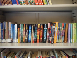 A shelf of books donated to the project.
