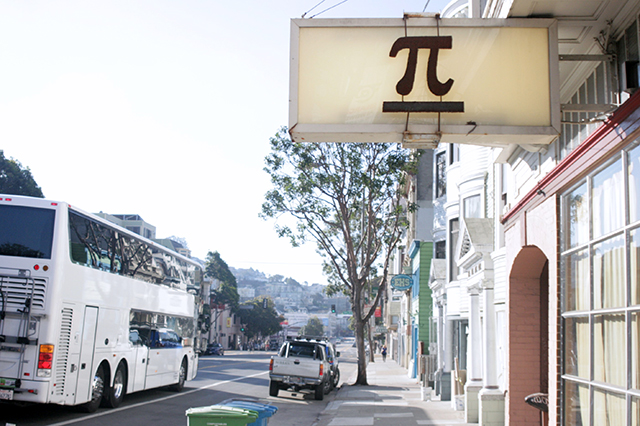 Pi the pizza shop and a Google bus on Valencia Street.  Photo by David Watterson