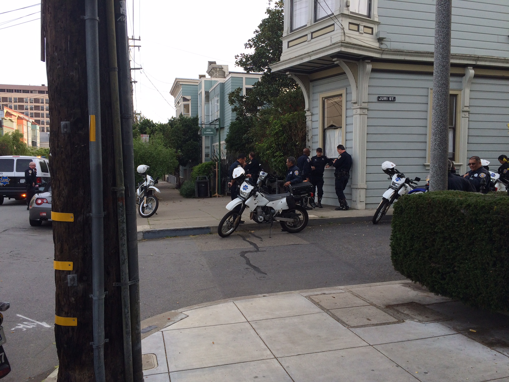 Police stand by motorbikes they used to patrol the Bernal Heights Park trail. Photo by Mark Rabine.