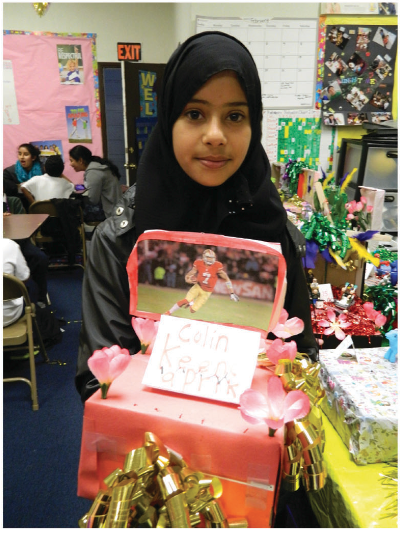 Amal Shaibi with her Colin Kaepernick float. Photo courtesy of Carolyn Deevy.