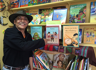 Argueta with some of his books. Photo by Lydia Chávez