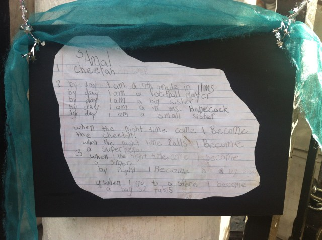 A poem was posted at the gate with flowers. It was written by Amal, possibly as a school assignment. It reads (sic): 1. Cheetah. 2 By day I am a 7th grader in Jims. By day I am a football player. By day I am a big sister. By day I am in Md. Babecock. By day I am a small sister. When the night time come I become a Cheetah. When the night time falls I become a superhero. When the nighttime come I become a singer. By night, I become a big sister. When I go to a store I become a bag of takis.